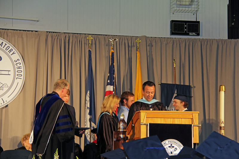 Caroline & Caleb present Wyatt with his diploma