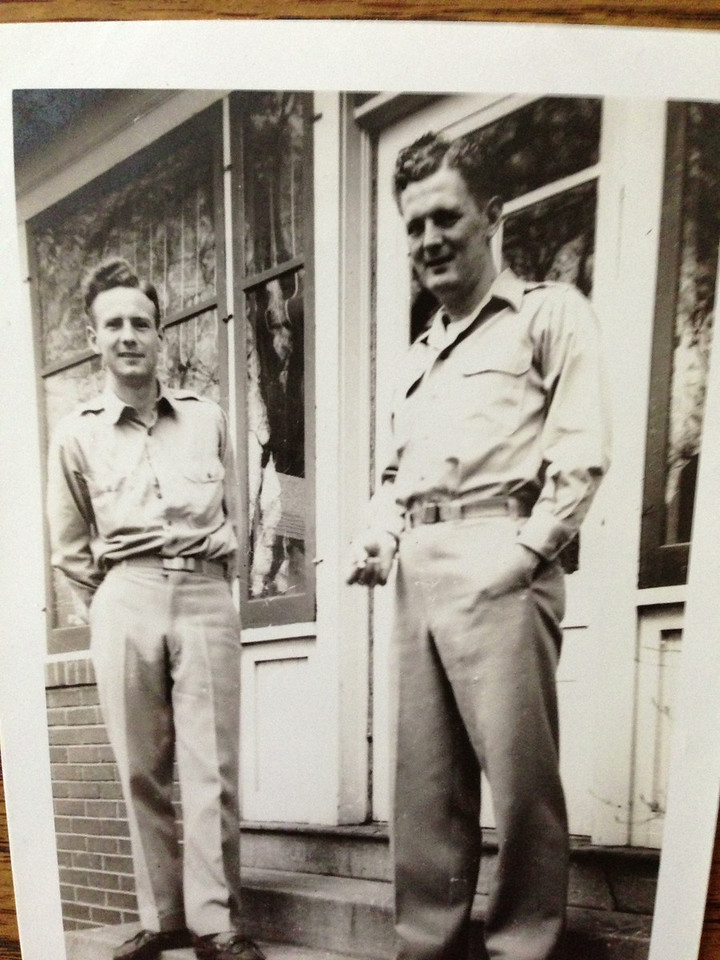 Rodger and John Naeseth in front of their home in Minneapolis