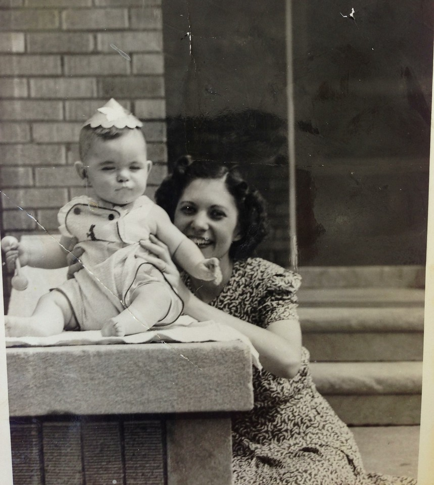 Diane Diskin with Sandy.  At duplex house near Linwood part of Detroit. David lived in upstairs with parents and Sandy until he was 3.