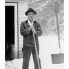 Otto shoveling snow at Pioneer house. Circa 1965 (restored)