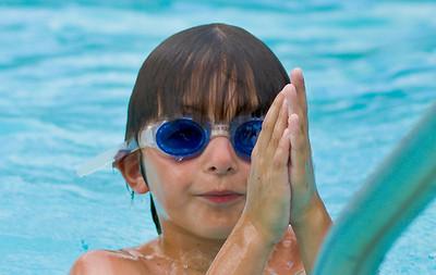 Patrick greets the Dalai Lama in the swimming pool.