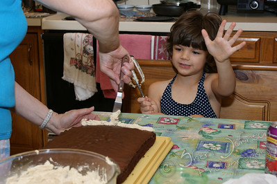 "helping Grandma ""make"" a cake"