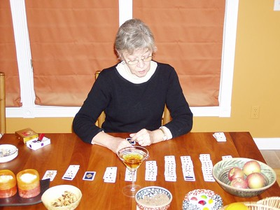 Madame Betty will read your fortune through the application and interpretation of her magical deck of cards - just as soon as she finishes her drink and game of solitaire.