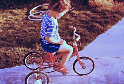 Hadas on new French tricycle, April 1959, Degania B