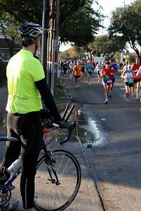 Biker watching Houston Marathoners