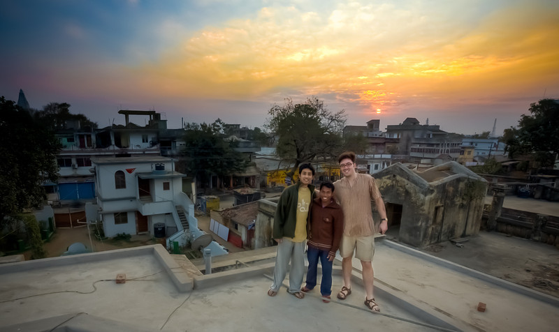 The Three Amigos, Hazaribagh, Jharkhand India<br /> <br /> From left to right, Kaushik, Dinesh and Paul.  In total I've spent about a month in Hazaribagh over the last few years and I've never seen a cloud in the sky.  But on this day it was quite cloudy and I knew there could be a nice sunset.  So I convinced my father in law to let the three amigos climb up to the roof for some sunset photos.  Kaushik is Nini's brother and Dinesh is the handy-man of the house.  The three of us are always getting into something when I'm in town.<br /> <br /> This is a three exposure HDR.  The selective de-ghosting tool in Photomatix has opened a whole new world of HDR portraiture.  <br /> <br /> Happy new year in advance!  We're about 12 hours ahead of the states over here so I'll be partying and trying to catch a college bowl game or two later tonight.<br /> <br /> Daily photo: Dec 30, 2011, taken Dec 30, 2011