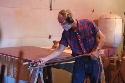 Lloyd, Jenny's husband, making a table out of purple heart wood for Dennis.