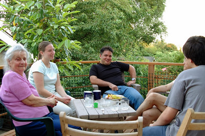 Eating dinner on Judy's deck in Seattle summer of 2006.  Mom, Cindy, Kento, Seishi (half hidden), and the back of Raymen.