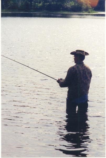 This is exactly how I'll always remember my Dad when he fishes--Camouflage hat, jacket, weighters, fishing pole, cigarette, and a band-aid can full of worms.
