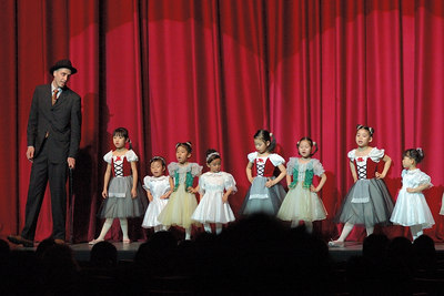 Keith recently choreographed the introduction to a ballet as part of his English teaching job.  Here he is on stage, performing with his students.