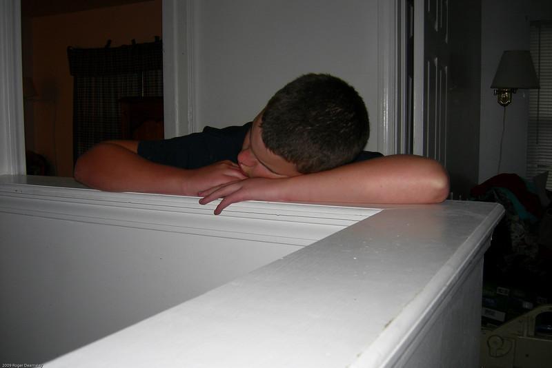 Allan sleeping on banister (4 of 6)