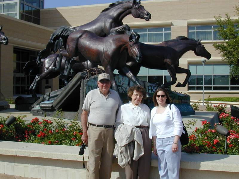 Que, Mom, and Tracy at the Bush Library.  The horses behind them are jumping over the broken Berlin wall, toppled during Bush's term
