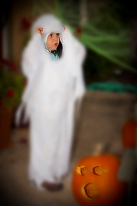 "Nicholas on Haloween as a ""gohst Cookie with sprinkles"" Played with the image in PS to give a moore spooky effect"