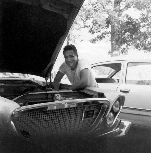 Dad working on the car in Spring Valley.<br /> Actually, I remember taking this shot.