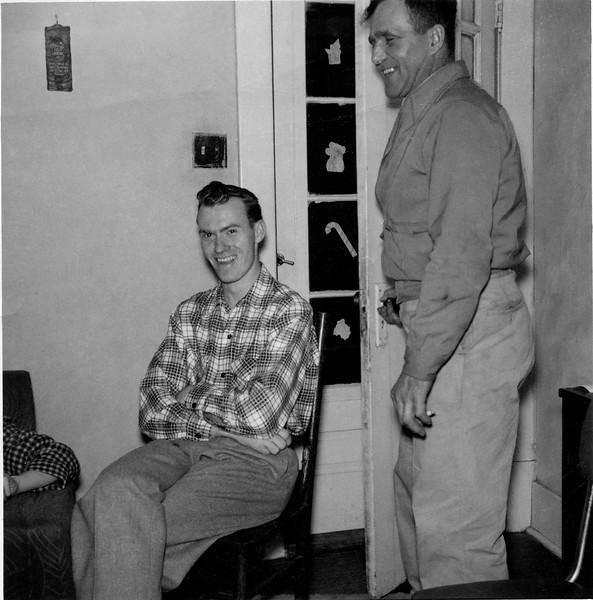 Uncle Charles and Granpa Burt at Grandma Wilson's house.