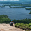 Jen looks out over Big Squam from the top of Rattlesnake.