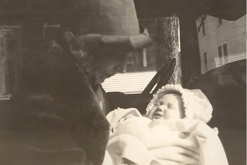 Laura holds Baby Cherry, age 2 mos,  in their Car in Eau Claire, Wisconsin