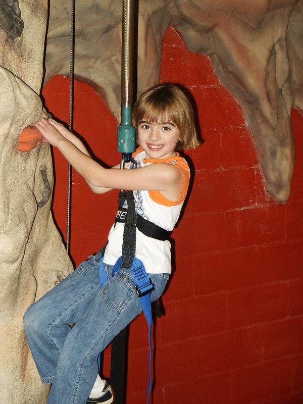"""No Fear"" Emma scales the climbing wall."