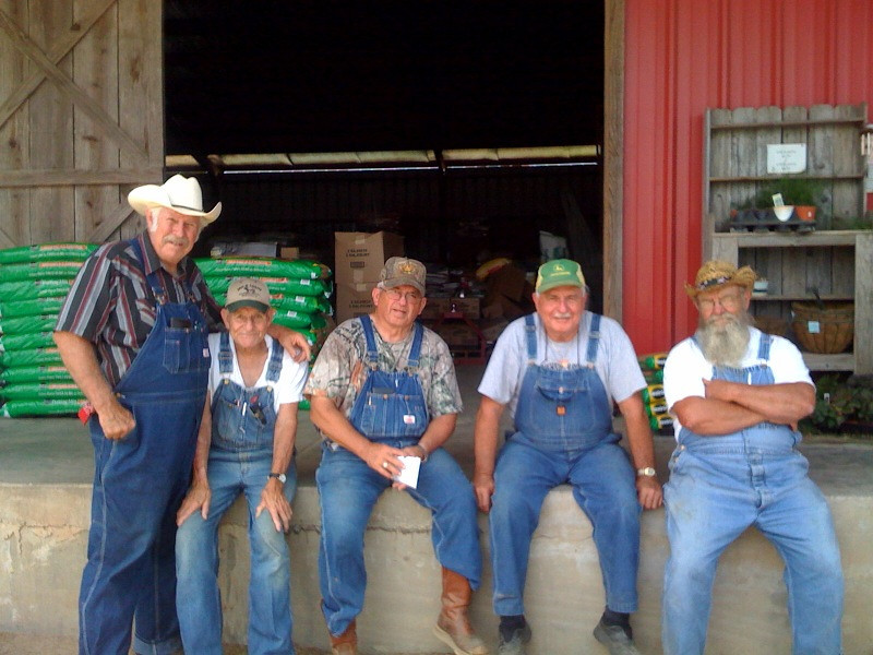 Old farmers at the feed store. This pic ended up on the local news paper. The one in the green cap is my Dad.