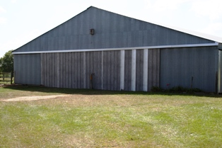 Dad repaired the Barn doors that were damaged by hurricane Rita over two years ago. September 2007