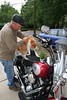 Dad trying to get the cat to sit on his harley