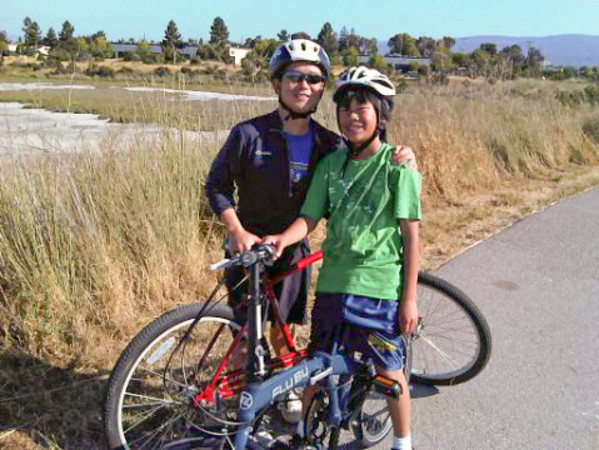 Andrew and me on our bikes. Andrew is riding my new foldable FlyBy while I'm riding a rented red cruiser.