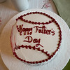 "A slightly battered ""baseball"" Cake."