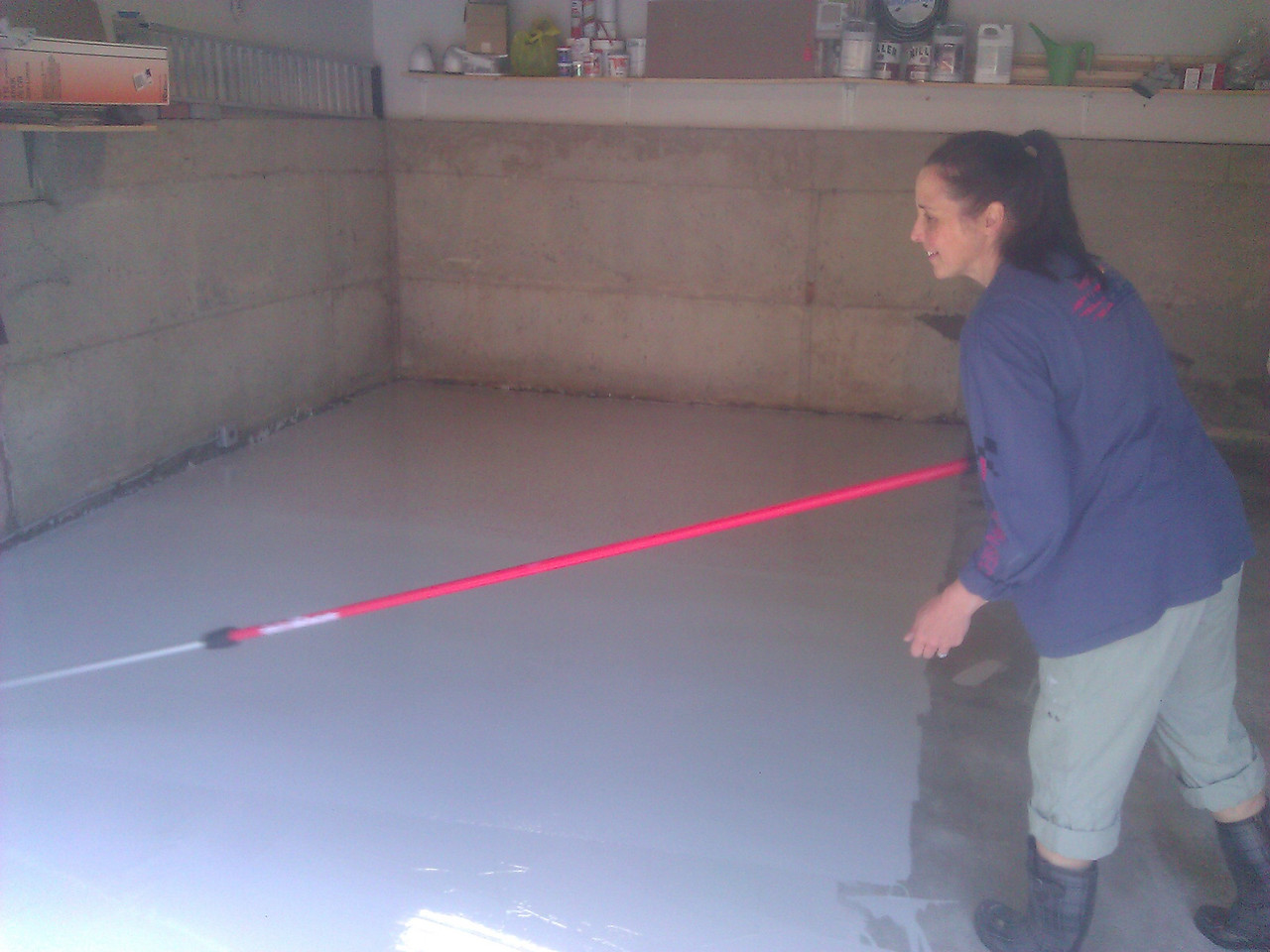 My wonderful wife helping put our new garage floor down.  She was showing the mad skillz.