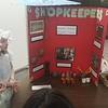 Their pioneer-era 5th grade shopkeeper project.