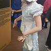 Lila (dressed in Mommy's old dress and apron) as a pioneer-era shopkeeper for a project at school. 5th grade.