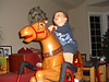 Somebody likes riding his horsie!