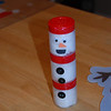 Look at our cute snowman we made using spice containers, googly eyes, buttons, cotton balls and construction paper.