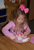 Camden decorating her cookie at her Valentine's party.