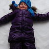 This girl has been waiting all winter long to make a snow angel