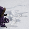 Writing her name in the snow.