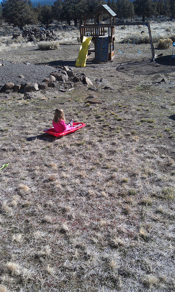 Lena wishing there was snow for sledding!
