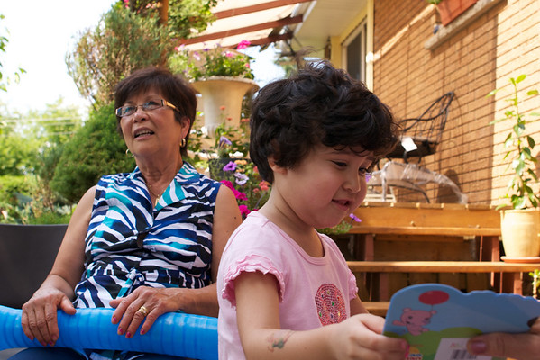 Opening more presents while Grandma chats in the background