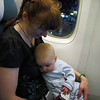<b>8 Dec 2010</b> On the Air New Zealand plane - the flight from Vancouver to Auckland.  He gets a little extension seatbelt you attach into your own.