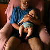 <b>24 Dec 2010</b> Sleeping on grandpa - more evidence for the beard and glasses in his future
