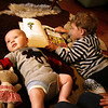 <b>13 Dec 2010</b> Finn enjoying hanging out with Kai on the cattle-skin rug
