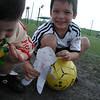 Logan and Jake playing soccer with Stanley