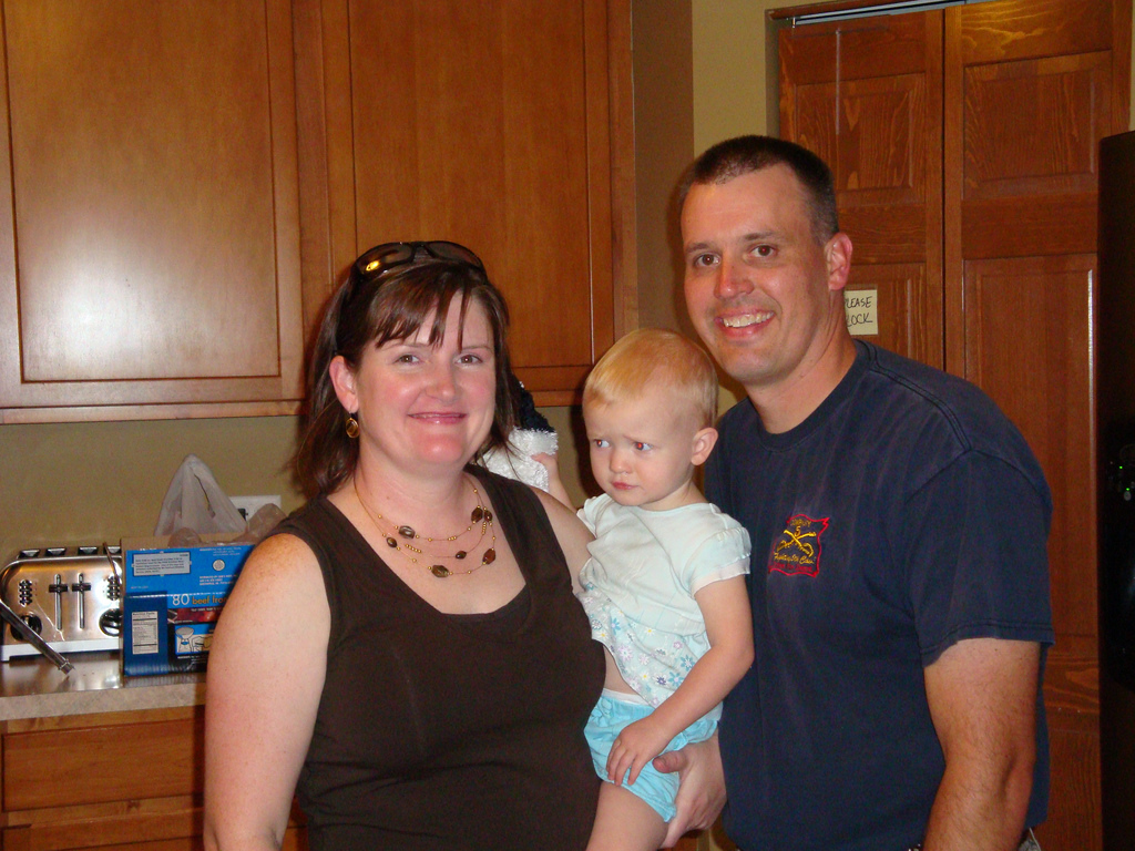 Eileen, Mike Flood's oldest daughter, with her husband Aaron and their youngest daughter, Grania.