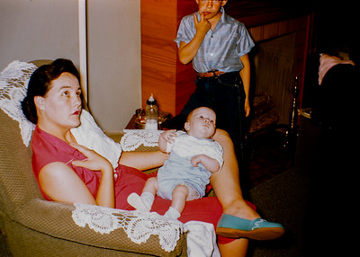 Probably 1957.  L to R, Mary Sue Ford, baby Fred Ford (probably). Background, Marty Ford.