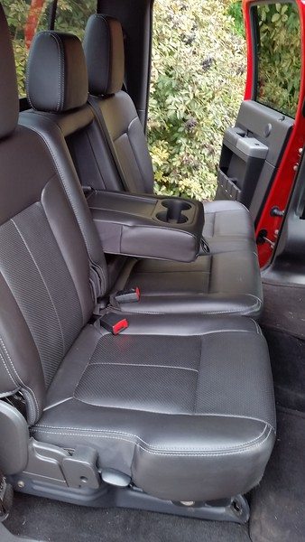 Rear seating with lockable storage bemeath,  all in leather.