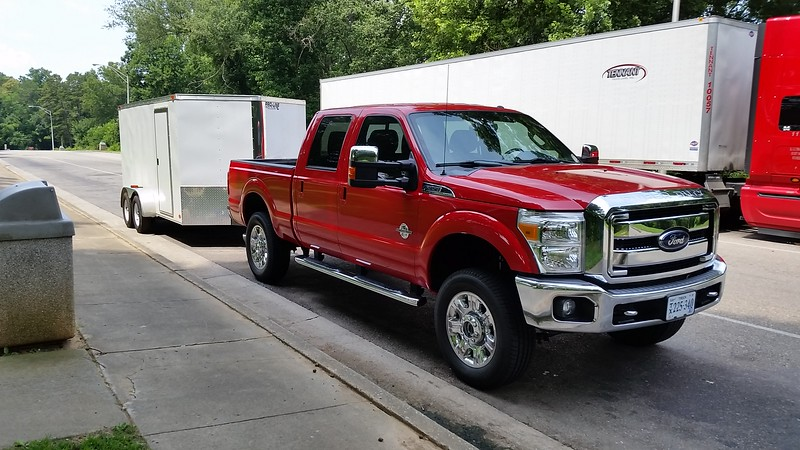 I never thought I'd own a red vehicle......and this one is RED.  But it's not only beautiful, but featured with everything I could want for towing and camping.