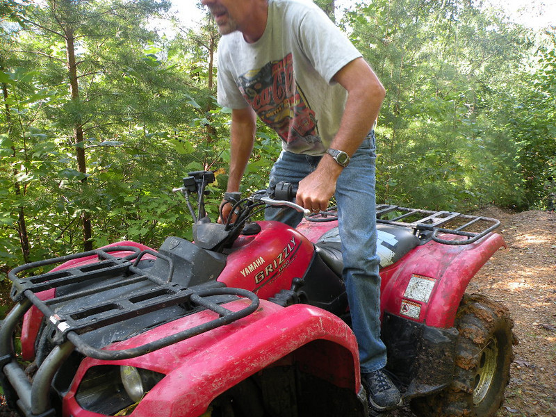 Bringing the other 4-wheeler up the steep bank