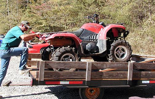 Getting the four-wheeler unloaded.