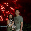 Catherine, Roscoe and Vu in front of the fireworks at Mission Viejo - shot @ ISO 500, f/8.0, 1/4 sec, on Panasonic DMC-GH2 w/ LUMIX G VARIO 14-140/F4-5.8 lens at 67 mm