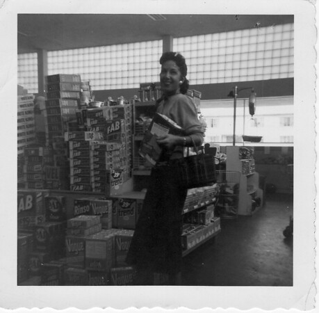 Conjet (Buono) Marino going to work at Cliffords Market at 3054 Rosecrans St.  Located south of the Loma Theatre, circa 1955. Phone number AC-3-5782