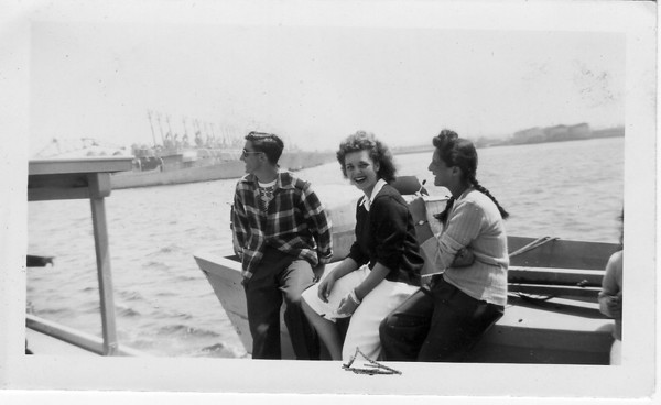 Left to Right: Unknown, Rosie (Buono) Ybarra, Chelee Buono sitting on the bait skiff of a tuna boat